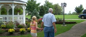 Why Bury Cremated Remains Family Holding Hands Cemetery